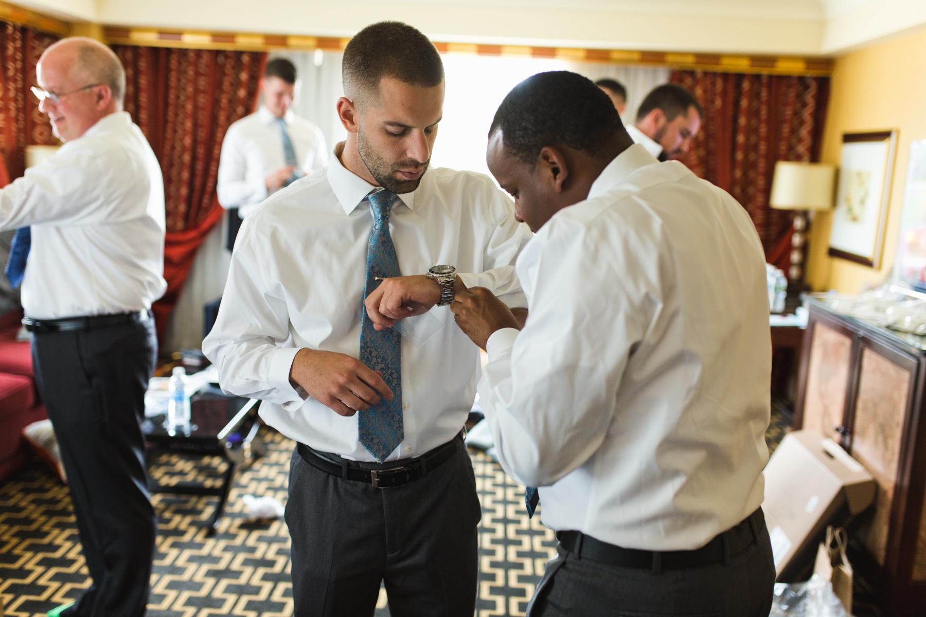 hotel marlowe groomsmen fixing watches and cufflinks