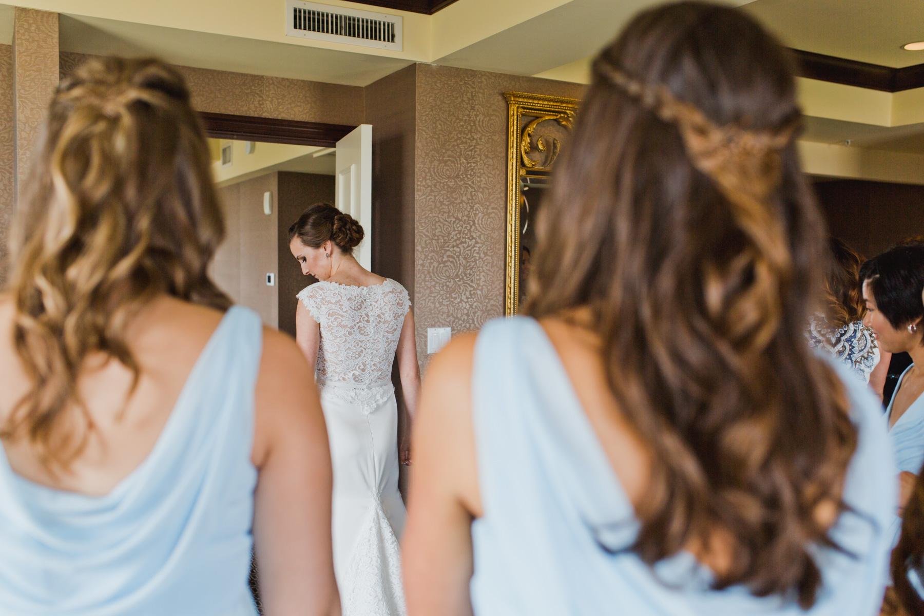 bridesmaids see dress and bride