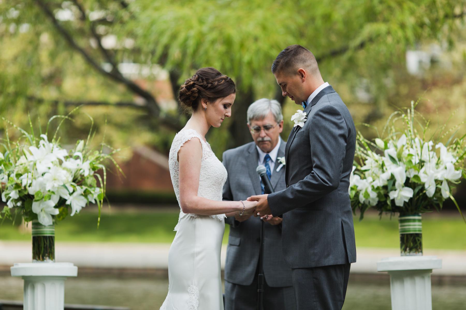 bride and groom exchange rings hotel marlowe wedding ceremony