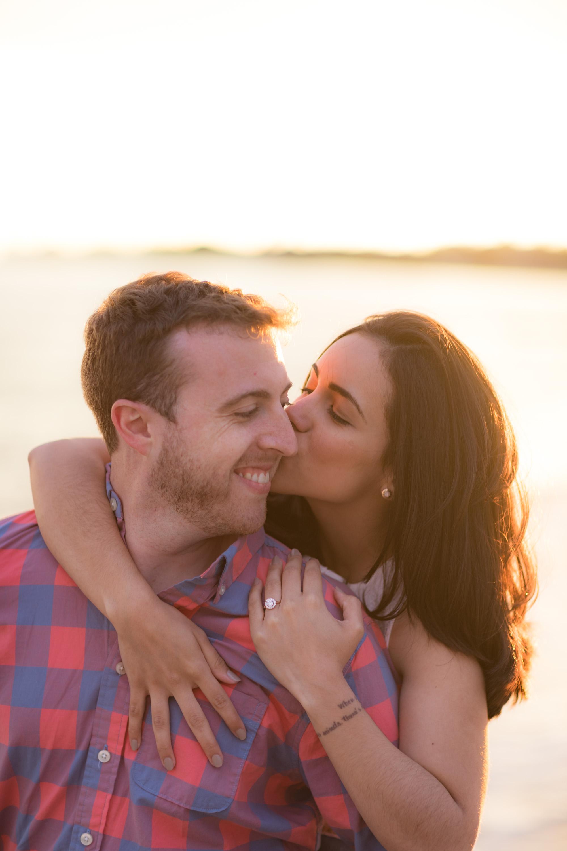 kiss on cheek at sunset