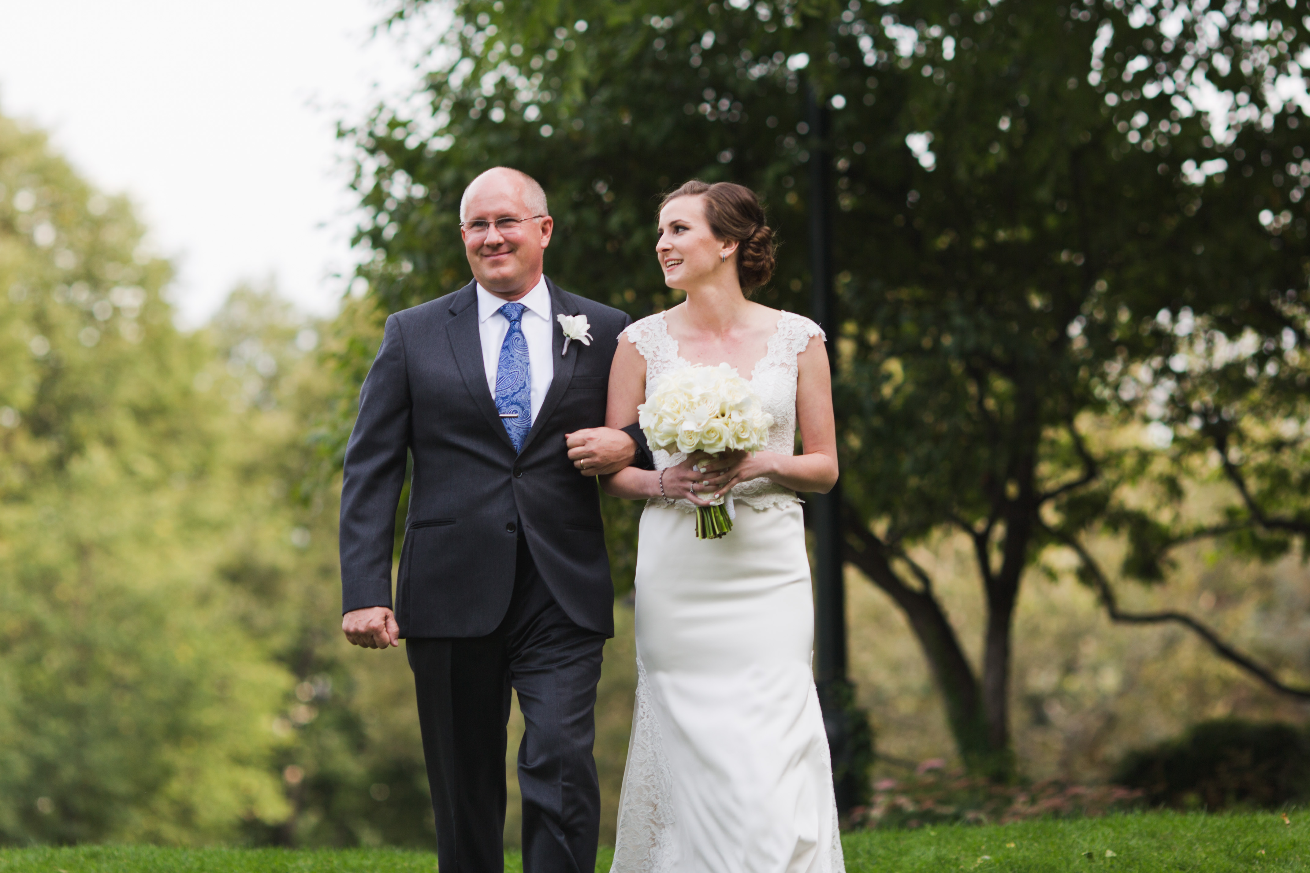 bride walking with father at hotel marlowe