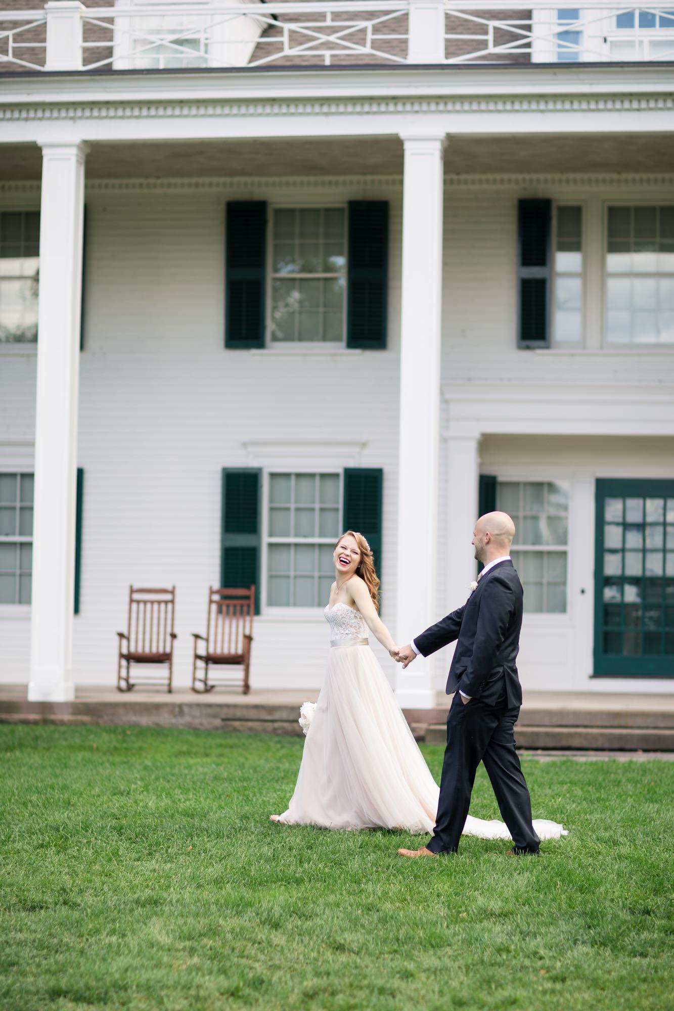 hillstead museum bride and groom walking