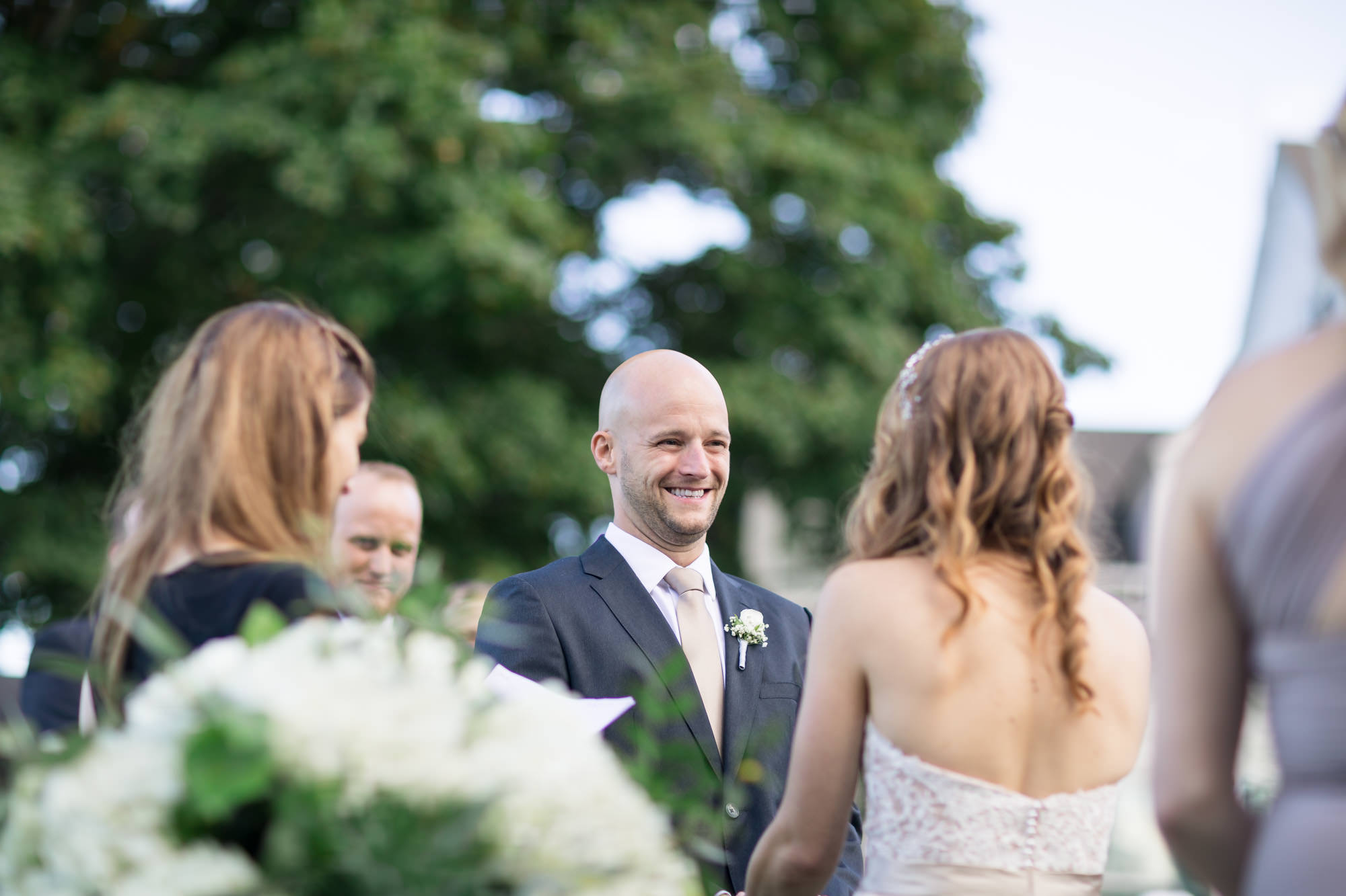 groom smiling vows